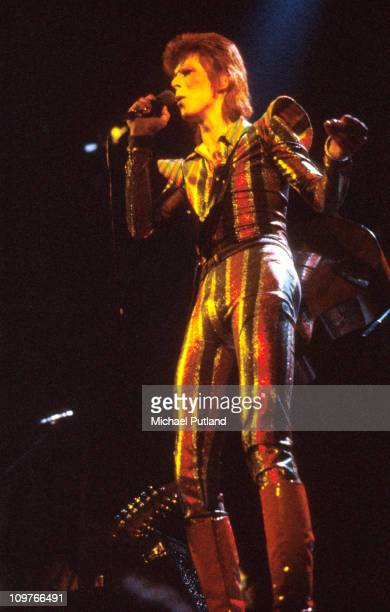 Singer David Bowie performing on stage during the Ziggy Stardust tour in 1973