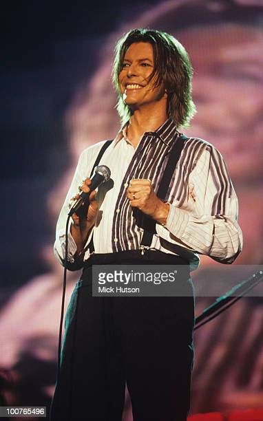 Singer David Bowie performs on stage during the NetAid concert held at Wembley Stadium in London England on October 09 1999