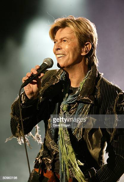 Singer David Bowie performs on stage on the third and final day of 'The Nokia Isle of Wight Festival 2004' at Seaclose Park on June 13 2004 in...