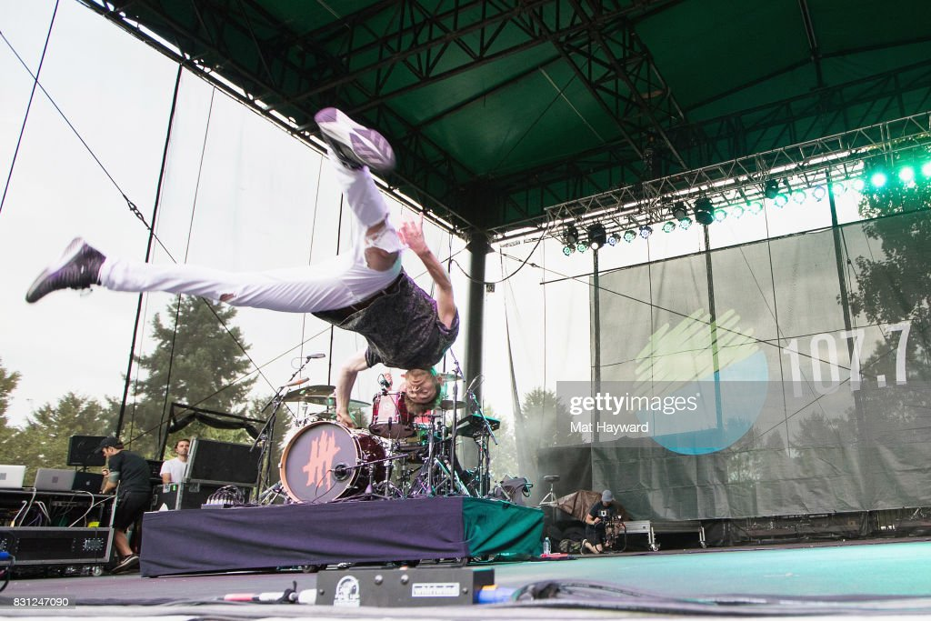 Singer David Boyd of New Politics break dances on stage during the Summer Camp music festival hosted by 107.7 the End at Marymoor Park on August 13, 2017 in Redmond, Washington.