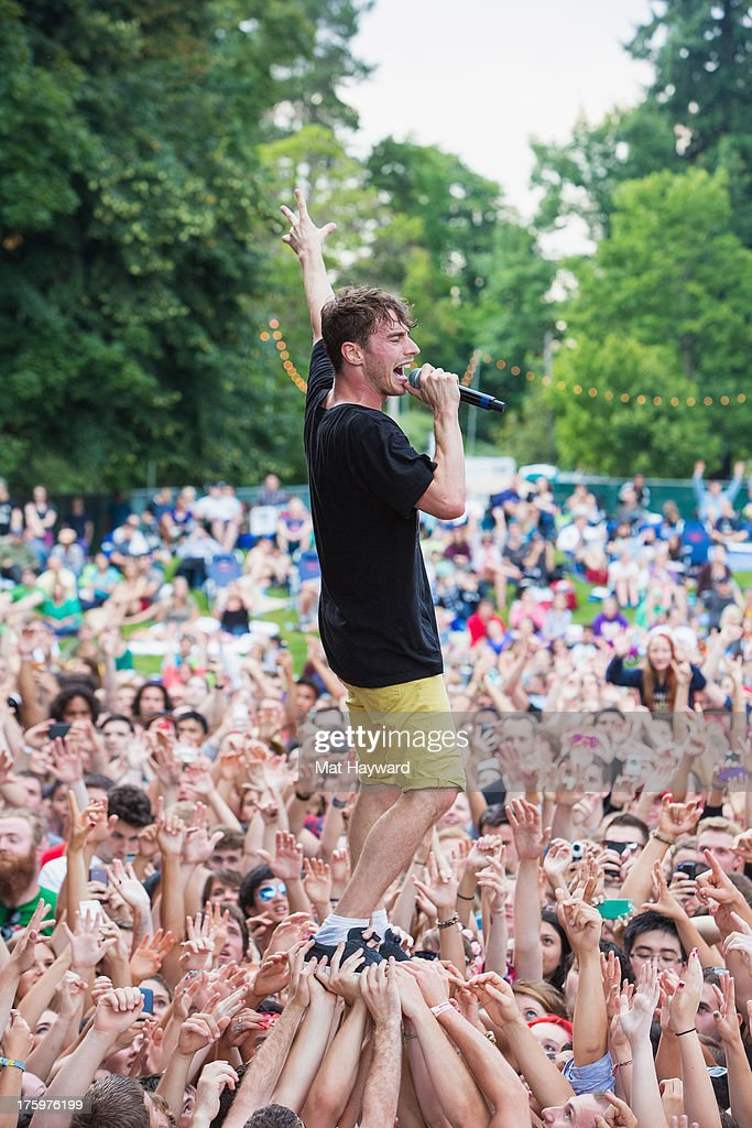 Singer David Boyd of New Politics of New Politics walks on the crowd during Summer Camp hosted by 107.7 The End at Marymoor Park on August 10, 2013 in Seattle, Washington.