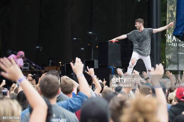Singer David Boyd of New Politics stands on the crowd while performing during the Summer Camp music festival hosted by 1077 the End at Marymoor Park...