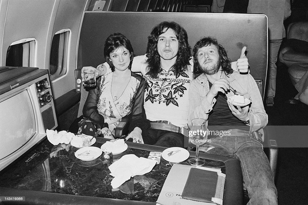 Singer David Coverdale (centre), of English rock band Deep Purple, in an aircraft during the band's tour of the US, 1974.