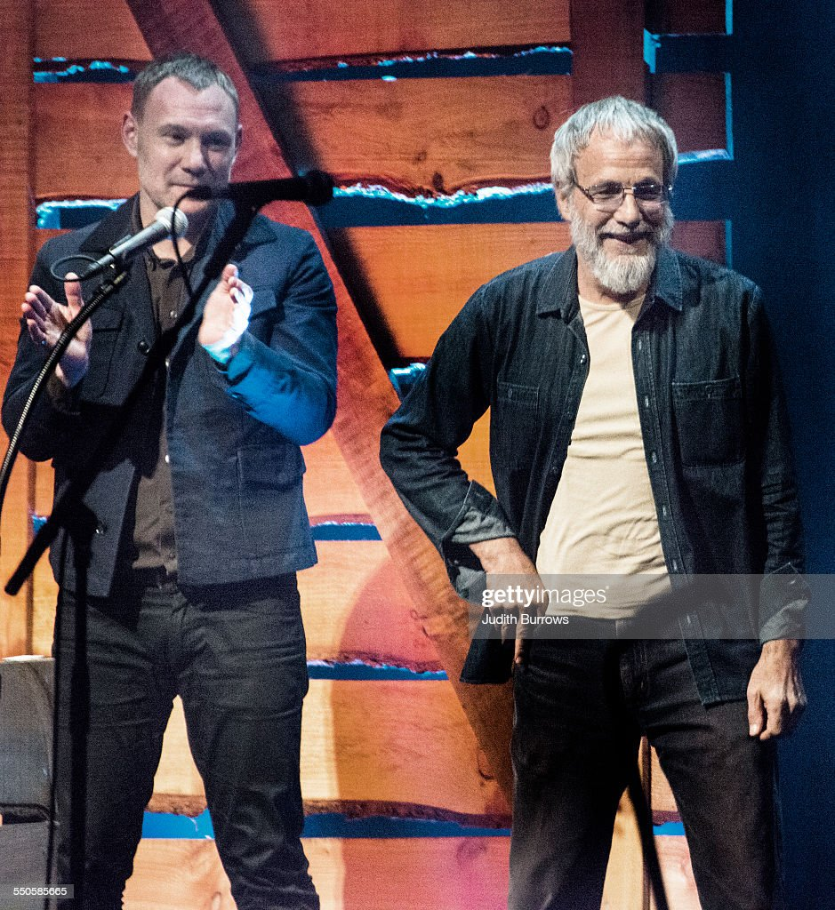 Singer David Gray (left) applauds after presenting the Lifetime Achievement award to British singer-songwriter Yusuf Islam (formerly known as Cat Stevens) at the 16th annual BBC Radio 2 Folk Awards at the Wales Millennium Centre, Cardiff, 22nd April 2015.