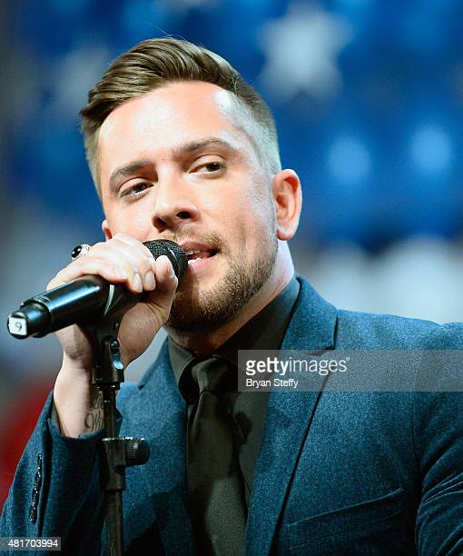 Singer David Hernandez performs during the DIRECTV and Operation Gratitude day of service at the fifth annual DIRECTV Dealer Revolution Conference at...