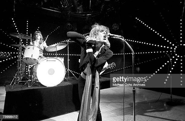 Singer David Johansen drummer Jerry Nolan of the rock and roll group 'The New York Dolls' pose for a portrait with host Don Steele on 'The Real Don...