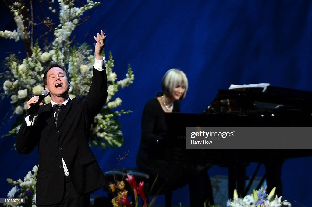 Singer Davis Gaines performs during a memorial service for Los Angeles Lakers owner Dr. Jerry Buss at the Nokia Theatre L.A. Live on February 21, 2013 in Los Angeles, California. Dr. Buss died at the age of 80 on Monday following an 18-month battle with cancer. Buss won 10 NBA championships as Lakers owner since purchasing the team in 1979.