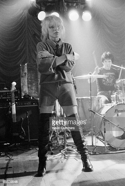 Singer Debbie Harry of American band Blondie wearing shorts and thigh high boots and drummer Clem Burke perform on stage at King George's Hall in...