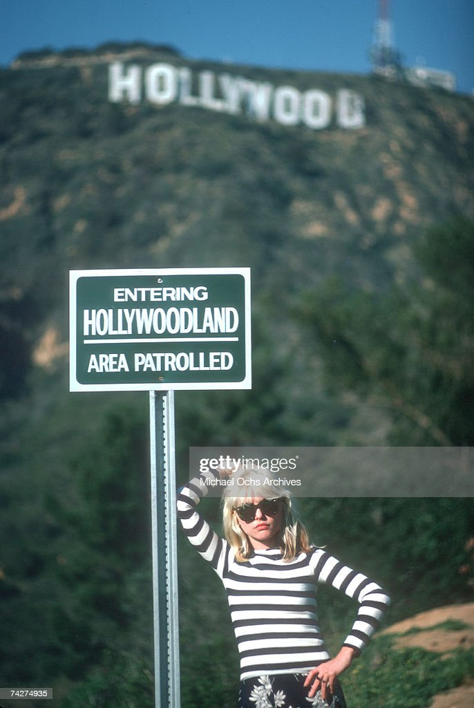 Singer Debbie Harry of the New Wave pop group 'Blondie' poses for a portrait in March 1977 on a hill beneath the Hollywood Sign in Los Angeles, California.