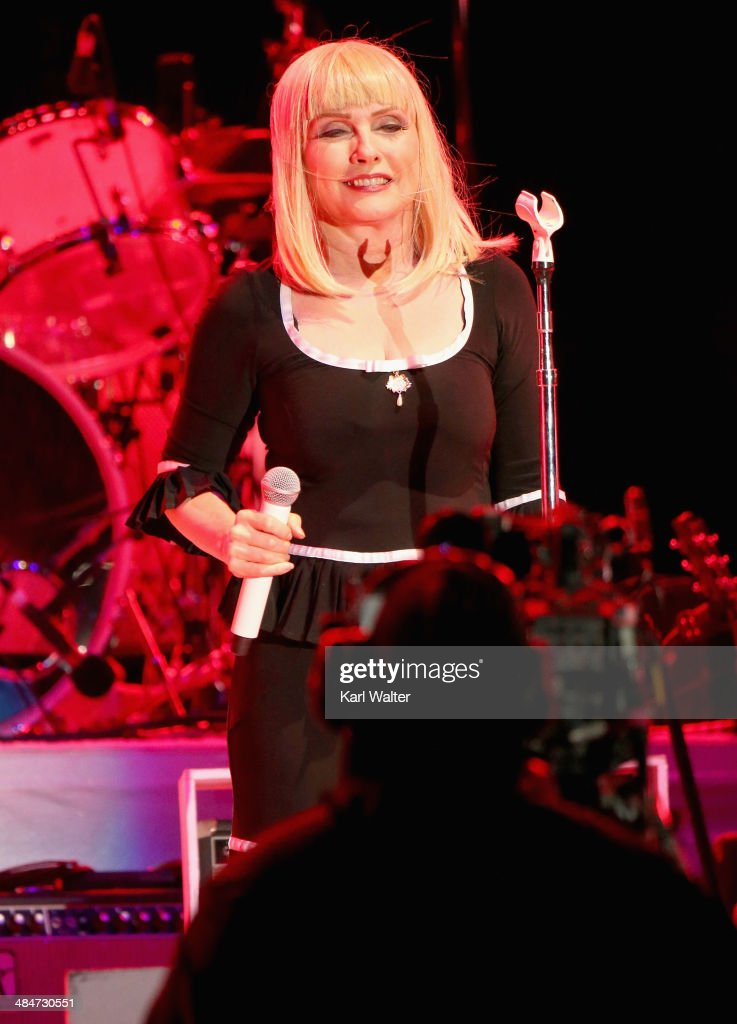 Singer Debbie Harry performs onstage with Arcade Fire during day 3 of the 2014 Coachella Valley Music & Arts Festival at the Empire Polo Club on April 13, 2014 in Indio, California.