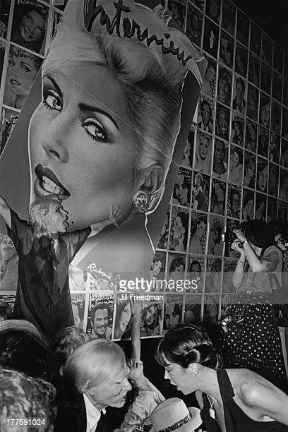 Singer Debbie Harry poses for a photographer at a Studio 54 party for 'Interview' magazine with Harry's appearance on the cover New York City 1978...