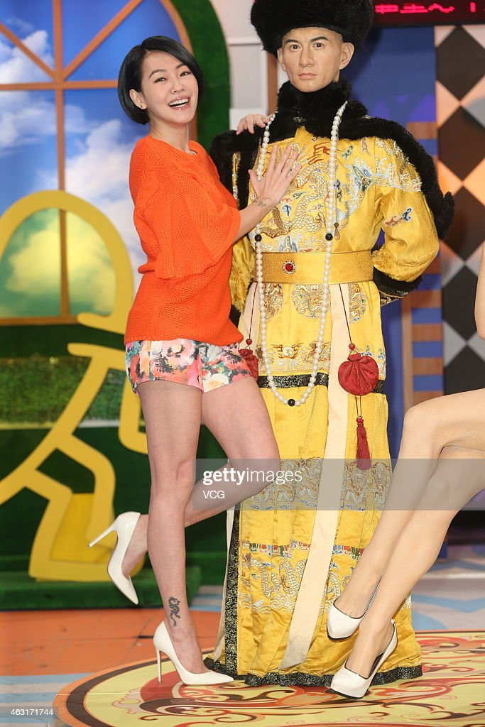 Singer <a gi-track='captionPersonalityLinkClicked' href=/galleries/search?phrase=Dee+Hsu&family=editorial&specificpeople=4238913 ng-click='$event.stopPropagation()'>Dee Hsu</a> flirts with actor <a gi-track='captionPersonalityLinkClicked' href=/galleries/search?phrase=Nicky+Wu&family=editorial&specificpeople=6739146 ng-click='$event.stopPropagation()'>Nicky Wu</a>'s wax figure made by Madame Tussauds on February 11, 2015 in Taipei, Taiwan of China.