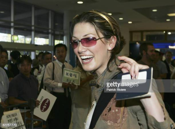 Singer Delta Goodrem arrives at Sydney Airport from England on March 1 2005 in Sydney Australia Goodrem has returned to her home country for an...