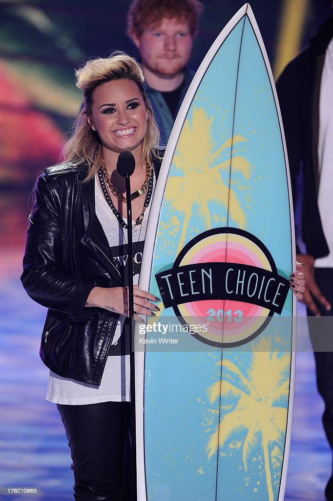 Singer Demi Lovato accepts Choice Female Artist award onstage during the Teen Choice Awards 2013 at Gibson Amphitheatre on August 11, 2013 in Universal City, California.