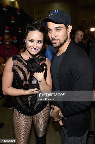 Singer Demi Lovato and actor Wilmer Valderrama attend the 2015 iHeartRadio Music Festival at MGM Grand Garden Arena on September 18 2015 in Las Vegas...