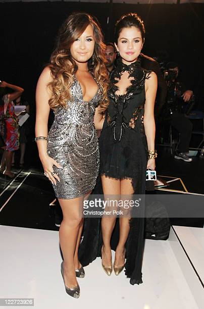 Singer Demi Lovato and actress Selena Gomez arrive at the 2011 MTV Video Music Awards at Nokia Theatre LA LIVE on August 28 2011 in Los Angeles...