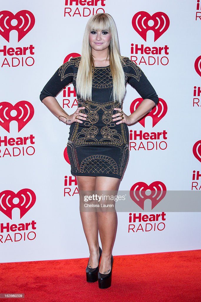 Singer <a gi-track='captionPersonalityLinkClicked' href=/galleries/search?phrase=Demi+Lovato&family=editorial&specificpeople=4897002 ng-click='$event.stopPropagation()'>Demi Lovato</a> arrives at iHeartRadio Music Festival press room at MGM Grand Garden Arena on September 21, 2012 in Las Vegas, Nevada.