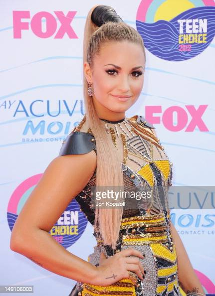 Singer Demi Lovato arrives at the 2012 Teen Choice Awards at Gibson Amphitheatre on July 22 2012 in Universal City California