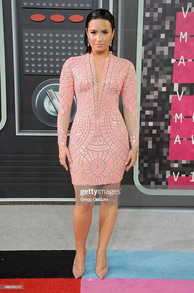 Singer Demi Lovato arrives at the 2015 MTV Video Music Awards at Microsoft Theater on August 30 2015 in Los Angeles California