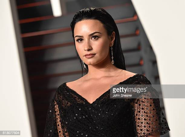 Singer Demi Lovato arrives at the 2016 Vanity Fair Oscar Party Hosted By Graydon Carter at Wallis Annenberg Center for the Performing Arts on...
