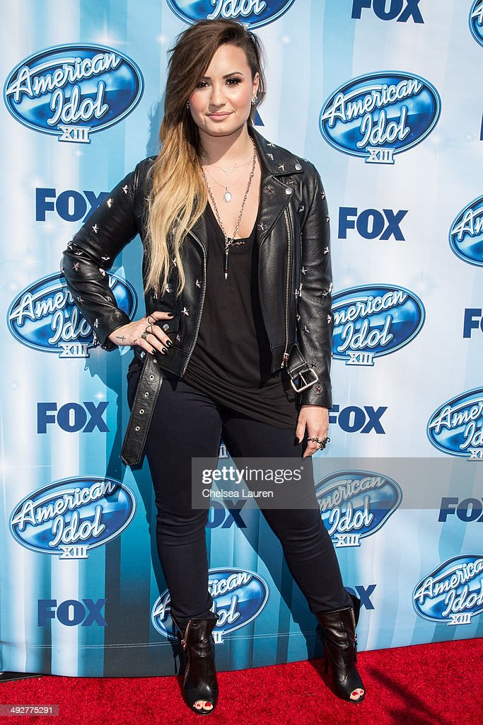 Singer Demi Lovato arrives at the American Idol XIII grand finale at Nokia Theatre LA Live on May 21 2014 in Los Angeles California