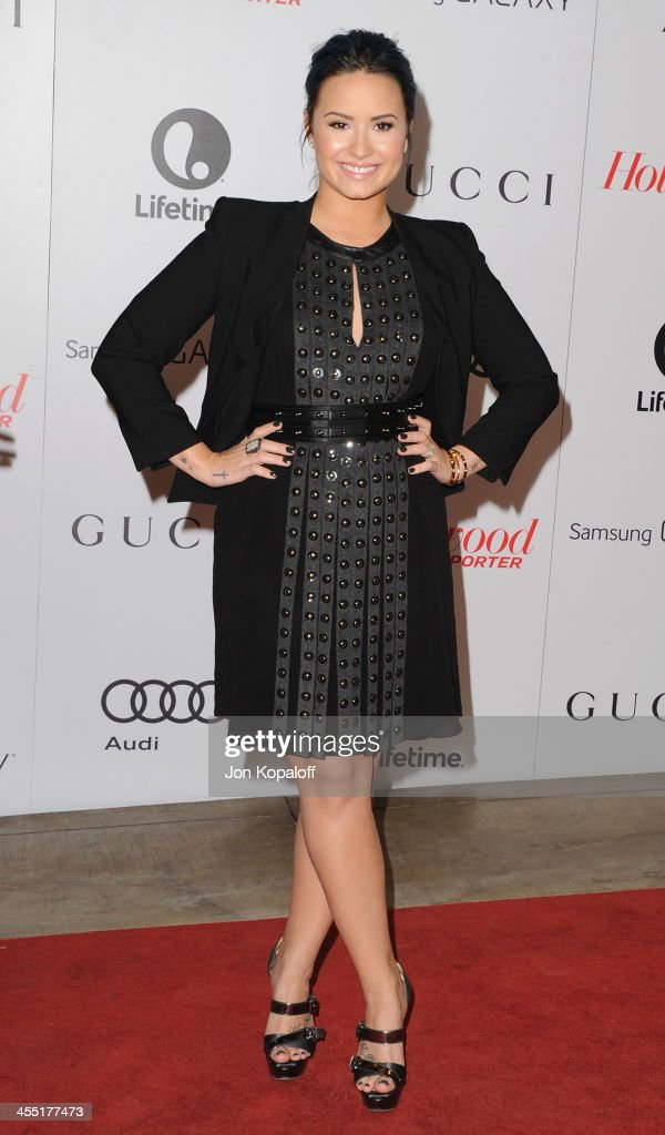 Singer Demi Lovato arrives at The Hollywood Reporter's 22nd Annual Women In Entertainment Breakfast 2013 at Beverly Hills Hotel on December 11, 2013 in Beverly Hills, California.