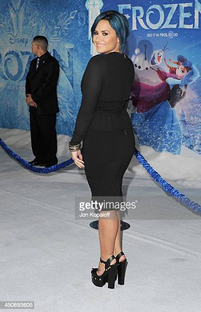 Singer Demi Lovato arrives at the Los Angeles Premiere 'Frozen' at the El Capitan Theatre on November 19 2013 in Hollywood California