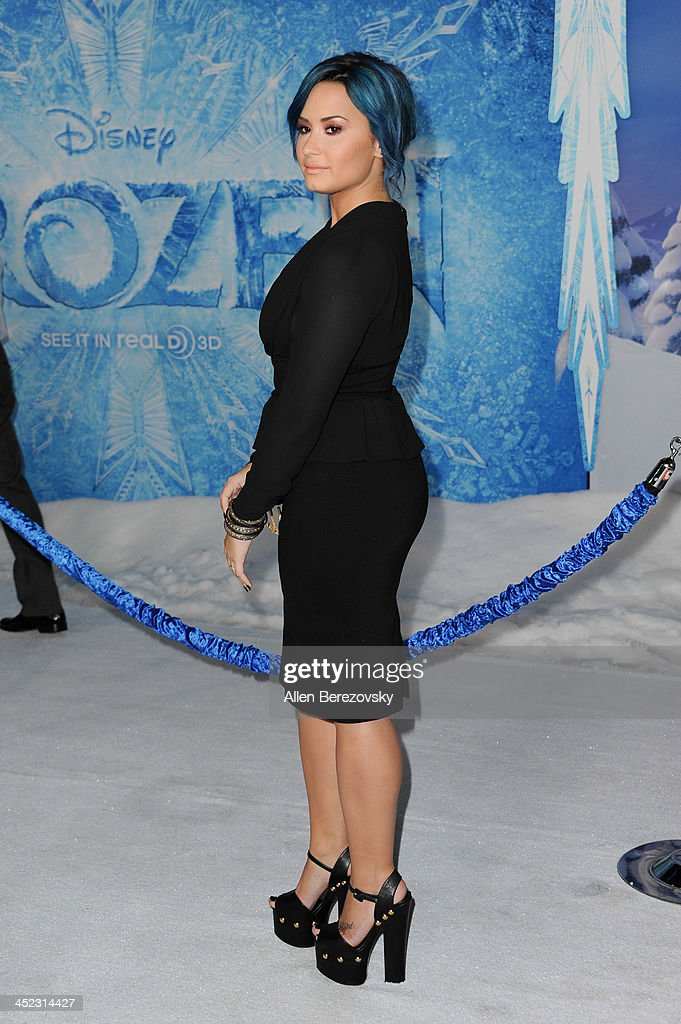 Singer Demi Lovato arrives at the Los Angeles premiere of Disney's 'Frozen' at the El Capitan Theatre on November 19, 2013 in Hollywood, California.