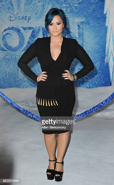 Singer Demi Lovato arrives at the Los Angeles premiere of Disney's 'Frozen' at the El Capitan Theatre on November 19 2013 in Hollywood California
