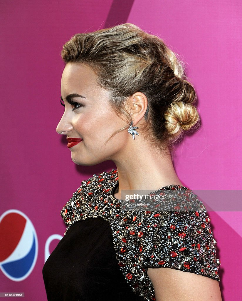 Singer Demi Lovato arrives at the premiere of Fox's 'The X Factor' Season 2 and handprint ceremony at the Chinese Theatre on September 11, 2012 in Los Angeles, California.