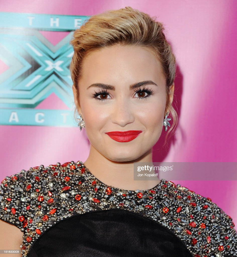 Singer Demi Lovato arrives at 'The X Factor' Season Two Premiere at Grauman's Chinese Theatre on September 11 2012 in Hollywood California