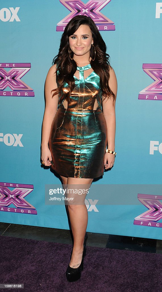 Singer <a gi-track='captionPersonalityLinkClicked' href=/galleries/search?phrase=Demi+Lovato&family=editorial&specificpeople=4897002 ng-click='$event.stopPropagation()'>Demi Lovato</a> attends the FOX's 'The X Factor' Season Finale - Night 2 at CBS Television City on December 20, 2012 in Los Angeles, California.