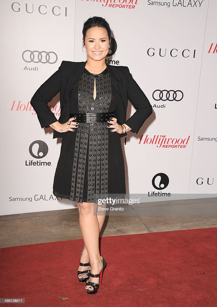 Singer Demi Lovato attends The Hollywood Reporter's 22nd annual Women In Entertainment Breakfast Honoring Oprah Winfrey at Beverly Hills Hotel on December 11, 2013 in Beverly Hills, California.
