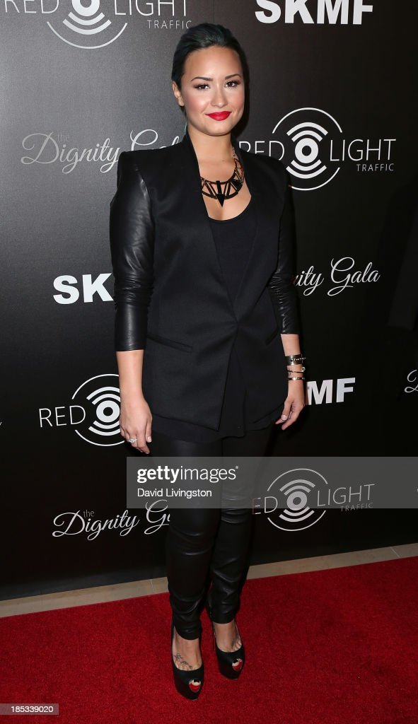 Singer <a gi-track='captionPersonalityLinkClicked' href=/galleries/search?phrase=Demi+Lovato&family=editorial&specificpeople=4897002 ng-click='$event.stopPropagation()'>Demi Lovato</a> attends the launch of the Redlight Traffic app at the Dignity Gala at The Beverly Hilton Hotel on October 18, 2013 in Beverly Hills, California.