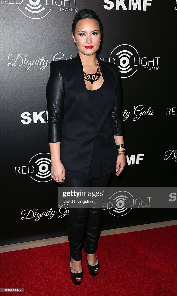 Singer Demi Lovato attends the launch of the Redlight Traffic app at the Dignity Gala at The Beverly Hilton Hotel on October 18, 2013 in Beverly Hills, California.