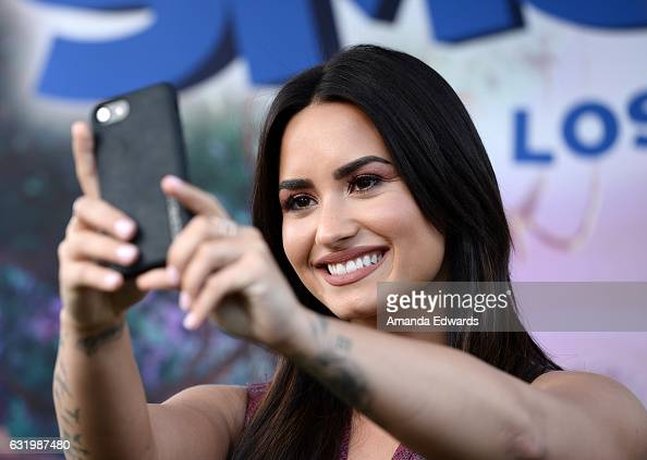 Singer Demi Lovato attends the photo call for Sony Pictures Releasing's 'Smurfs The Lost Village' at Sony Pictures Studios on January 18 2017 in...