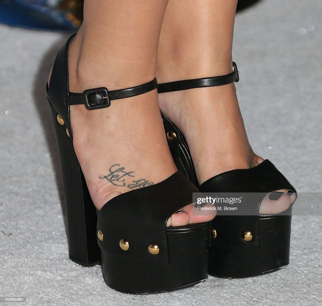 Singer Demi Lovato (shoe detail) attends the Premiere of Walt Disney Animation Studios' 'Frozen' at the El Capitan Theatre on November 19, 2013 in Hollywood, California.