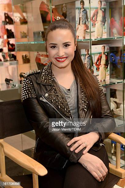 Singer Demi Lovato attends Topshop Topman LA Grand Opening at The Grove on February 14 2013 in Los Angeles California