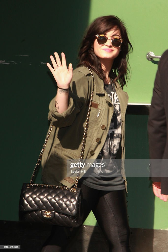 Singer <a gi-track='captionPersonalityLinkClicked' href=/galleries/search?phrase=Demi+Lovato&family=editorial&specificpeople=4897002 ng-click='$event.stopPropagation()'>Demi Lovato</a> departs 'Good Morning America' at GMA Studios on April 10, 2013 in New York City.