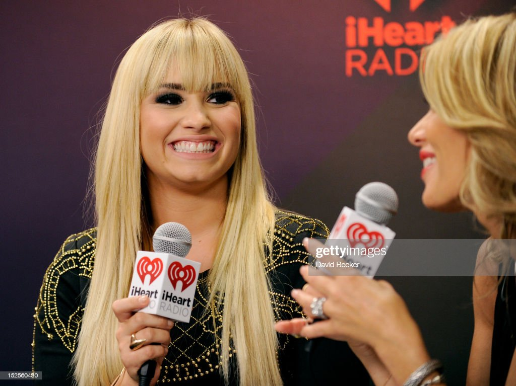 Singer <a gi-track='captionPersonalityLinkClicked' href=/galleries/search?phrase=Demi+Lovato&family=editorial&specificpeople=4897002 ng-click='$event.stopPropagation()'>Demi Lovato</a> is interviewed by radio host Ellen K in the Elvis Duran Broadcast Room during the 2012 iHeartRadio Music Festival at the MGM Grand Garden Arena on September 21, 2012 in Las Vegas, Nevada.