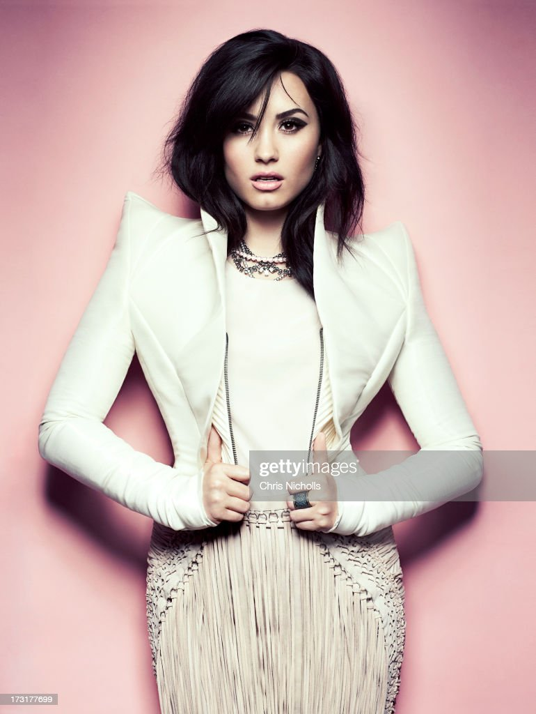 Singer Demi Lovato is photographed for Fashion Magazine on August 1, 2013 in Los Angeles, California. Jacket (Ilja), top and skirt (Salvatore Ferragamo), necklace (Tom Binns), ring (Roco). PUBLISHED