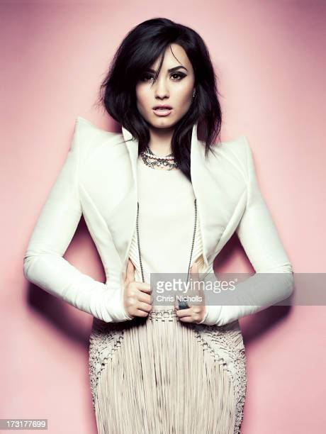 Singer Demi Lovato is photographed for Fashion Magazine on August 1 2013 in Los Angeles California Jacket top and skirt necklace ring PUBLISHED IMAGE...