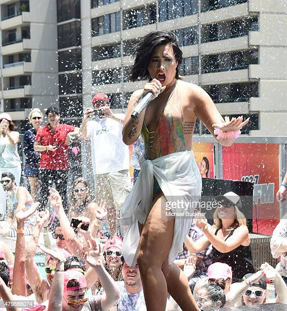 Singer Demi Lovato performs at 1027 Kiis FM's Cool For The Summer' Pool Party at the WaterMarke Tower on July 5 2015 in Los Angeles California