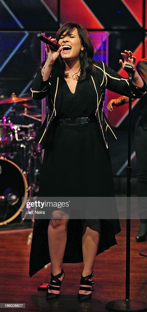 """MICHAEL -4/11/13 - Singer DEMI LOVATO performs her new #1 single, """"Heart Attack,"""" and talks about her upcoming album on 'LIVE with Kelly and Michael,' distributed by Disney-ABC Domestic Television. LOVATO"""