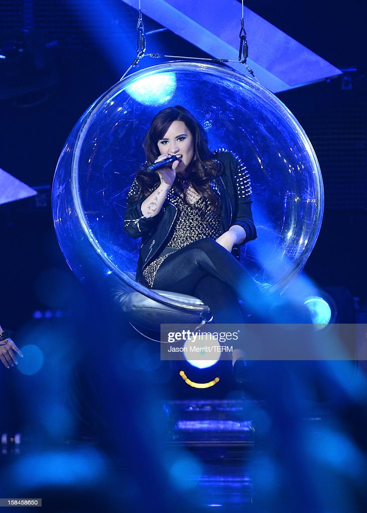 Singer Demi Lovato performs onstage at 'VH1 Divas' 2012 held at The Shrine Auditorium on December 16, 2012 in Los Angeles, California.