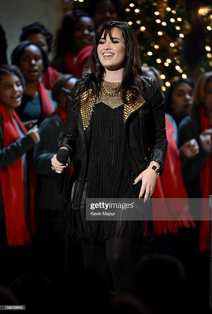 Singer <a gi-track='captionPersonalityLinkClicked' href=/galleries/search?phrase=Demi+Lovato&family=editorial&specificpeople=4897002 ng-click='$event.stopPropagation()'>Demi Lovato</a> performs onstage during TNT Christmas in Washington 2012 at National Building Museum on December 9, 2012 in Washington, DC. 23098_003_KM_1494.JPG