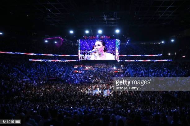 Singer Demi Lovato performs the national anthem before Floyd Mayweather Jr and Conor McGregor compete in their super welterweight boxing match on...