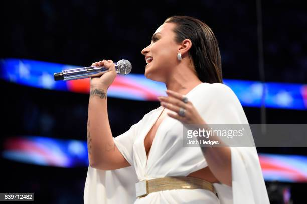 Singer Demi Lovato performs the national anthem prior to the super welterweight boxing match between Floyd Mayweather Jr and Conor McGregor on August...