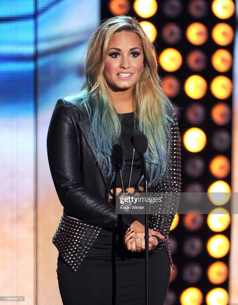 Singer <a gi-track='captionPersonalityLinkClicked' href=/galleries/search?phrase=Demi+Lovato&family=editorial&specificpeople=4897002 ng-click='$event.stopPropagation()'>Demi Lovato</a> speaks onstage during the 2012 Teen Choice Awards at Gibson Amphitheatre on July 22, 2012 in Universal City, California.