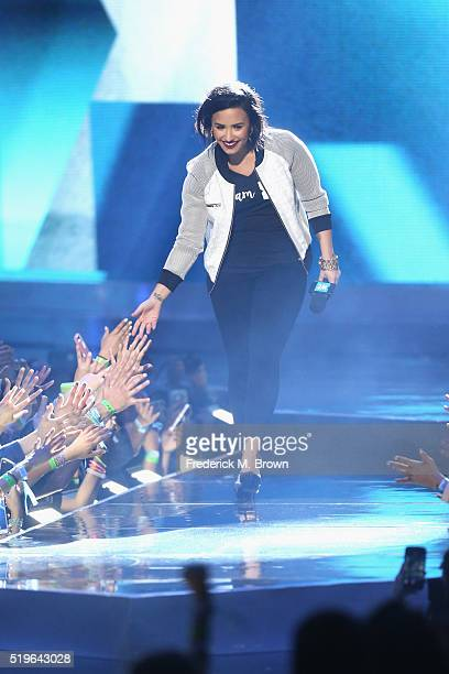 Singer Demi Lovato walks onstage at WE Day California 2016 at The Forum on April 7 2016 in Inglewood California